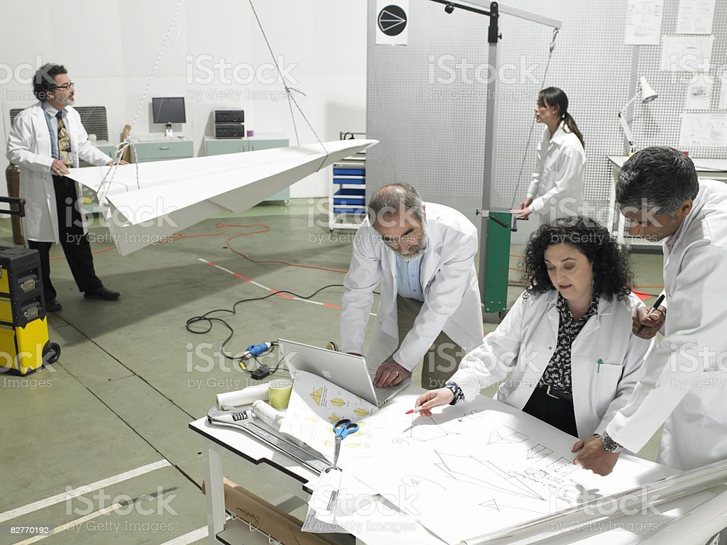 Scientist discussing plans in laboratory royalty free stockfoto