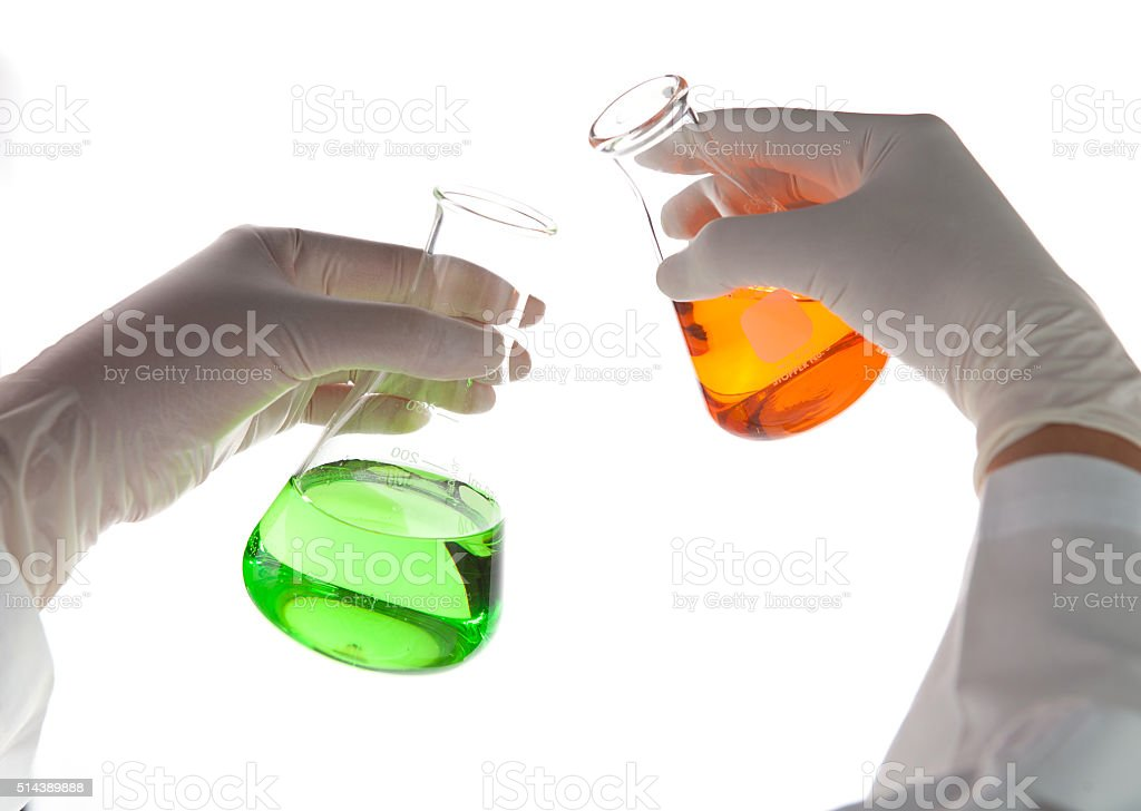 scientist doing chemical test stock photo