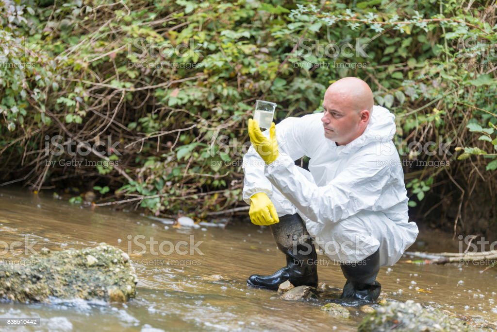 Scientist examing toxic water stock photo