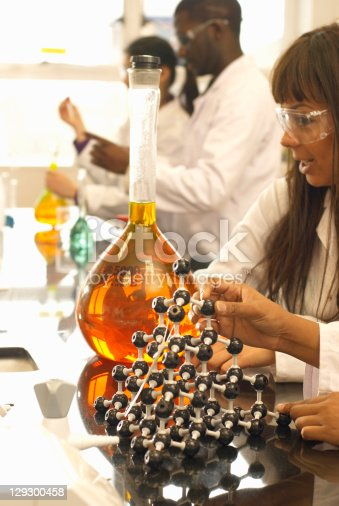 129300487 istock photo Scientist examining beaker in lab 129300458