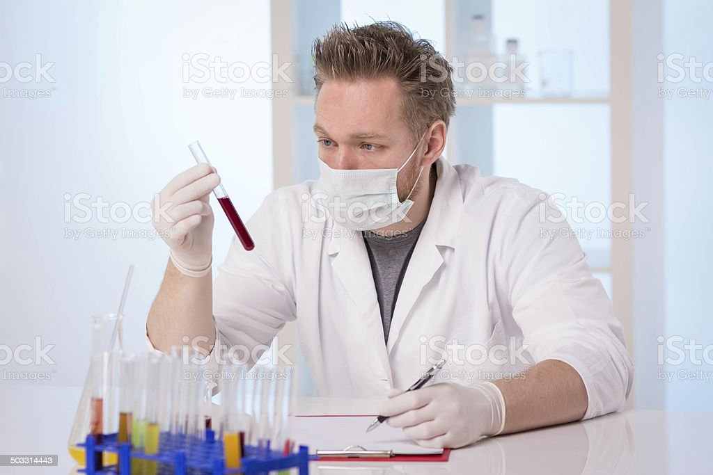 Scientist examining chemical mixture. stock photo