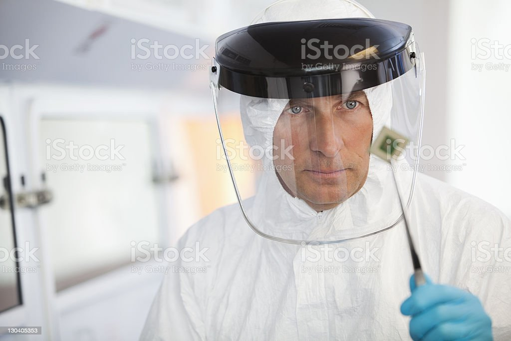 Scientist examining microchip in lab royalty-free stock photo