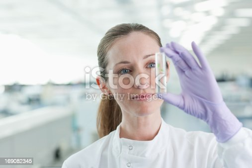 istock Scientist examining plant in test tube in lab 169082345