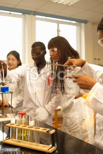 129300487 istock photo Scientist examining test tube in lab 129300481