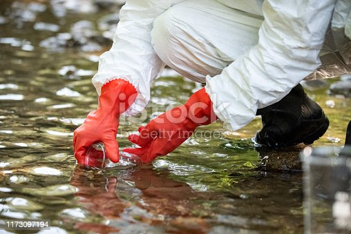 istock Scientist examining toxic water samples 1173097194