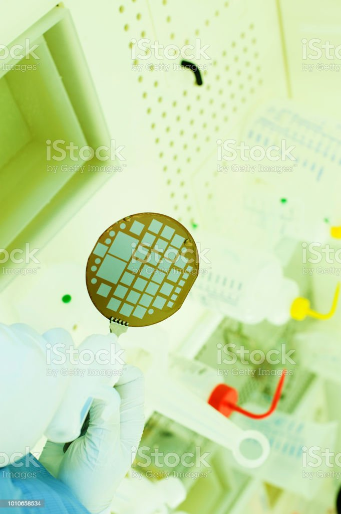 Scientist Fabricating Sensors On Semiconductor Wafer Stock