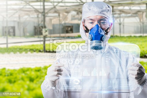 1096949092 istock photo Scientist farmer growing plant in green house lab with IOT based smart agriculture monitoring system, automate sensor robotic GMO free farming industry future internet of thing technology. 1221404748