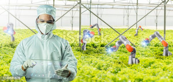 1096949092 istock photo Scientist farmer growing plant in green house lab with IOT based smart agriculture augmented reality monitor, automate AI sensor robot GMO free farming industry future internet of thing technology. 1249531676