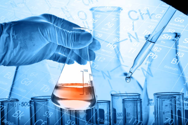 Scientist hand holding flask with test tubes background Scientist hand holding flask with test tubes background, science research and development concept biochemist stock pictures, royalty-free photos & images