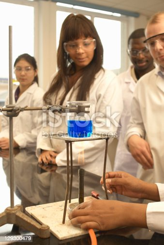 129300487 istock photo Scientist heating liquid in beaker 129300479