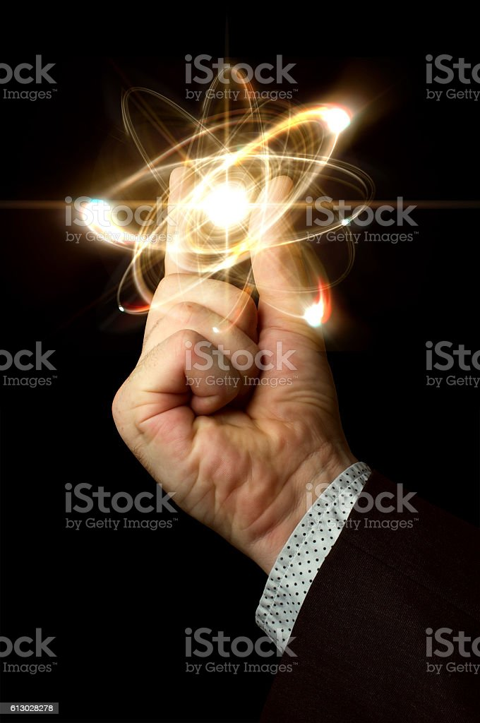 Scientist Holding Atom stock photo