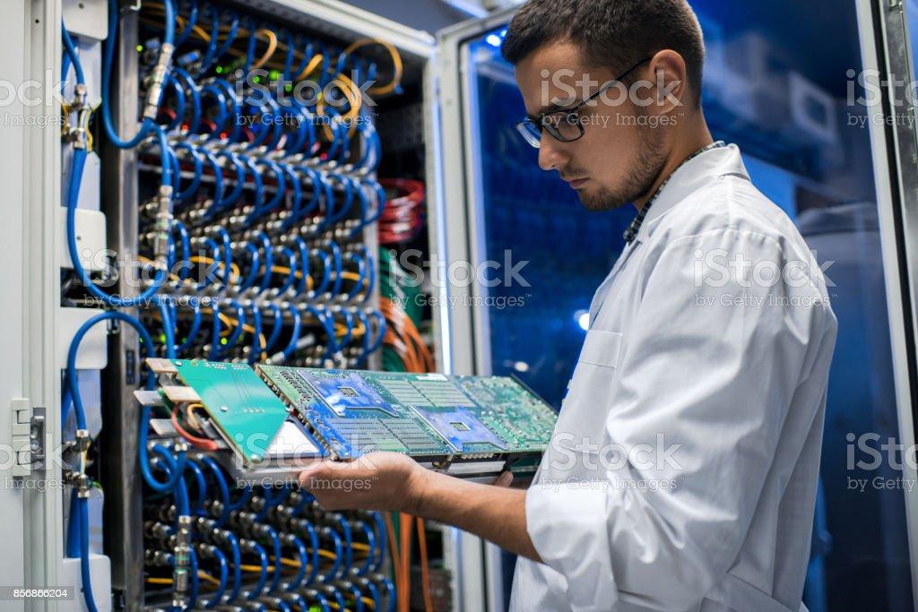 Scientist Holding Blade Server stock photo