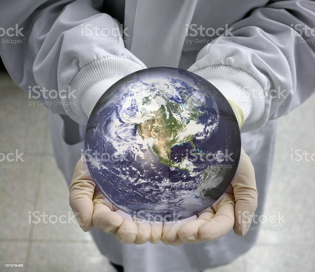 Scientist holds the world - Globe royalty-free stock photo