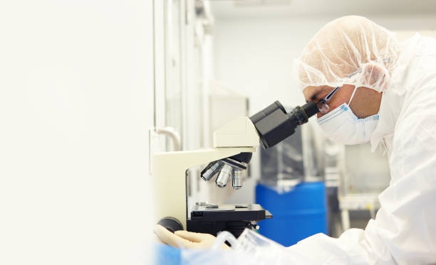 Scientist in a clean room stock photo