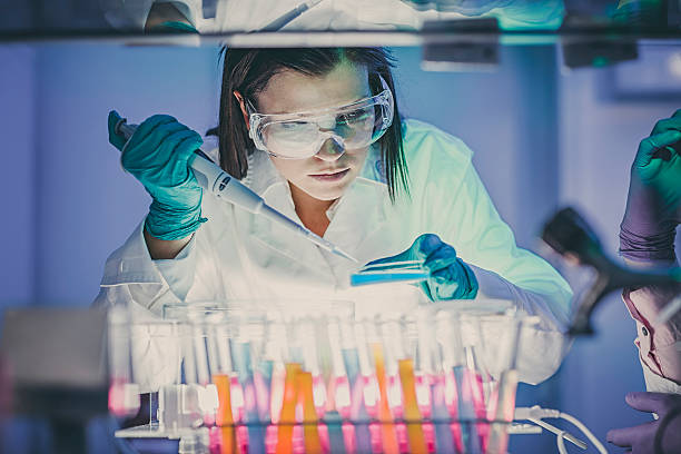 scientist  in laboratory - microbiology stock pictures, royalty-free photos & images
