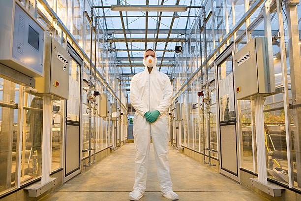 Scientist in protective suit stock photo