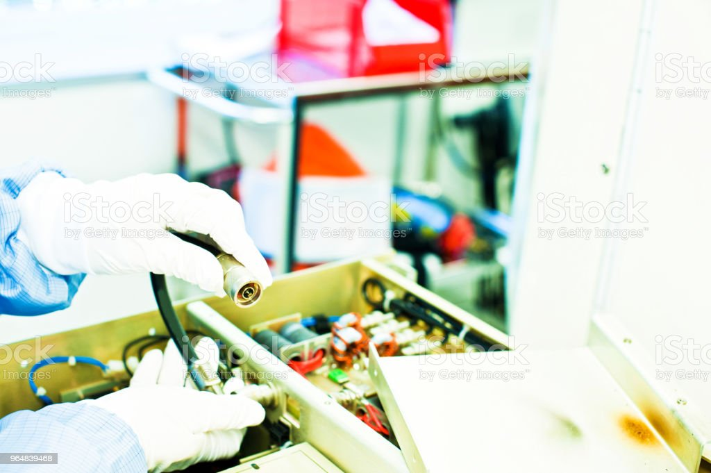 Scientist Inspects A Machine Spare Part In The Laboratory royalty-free stock photo