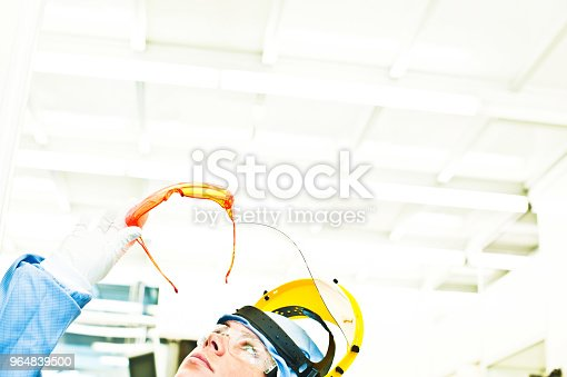 Scientist Inspects A Ultraviolet Radiation Protection Eyeglasses In The Laboratory Stock Photo & More Pictures of Adult
