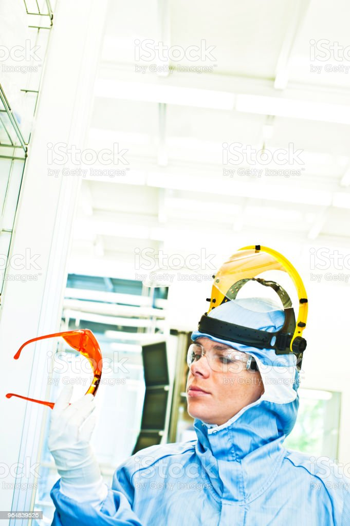 Scientist Inspects A Ultraviolet Radiation Protection Eyeglasses In The Laboratory royalty-free stock photo