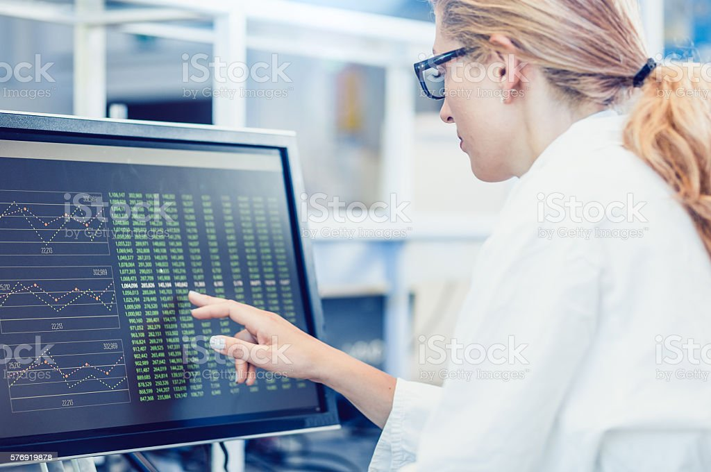 Scientist Interacting With The Computer Via Touch Screen – zdjęcie