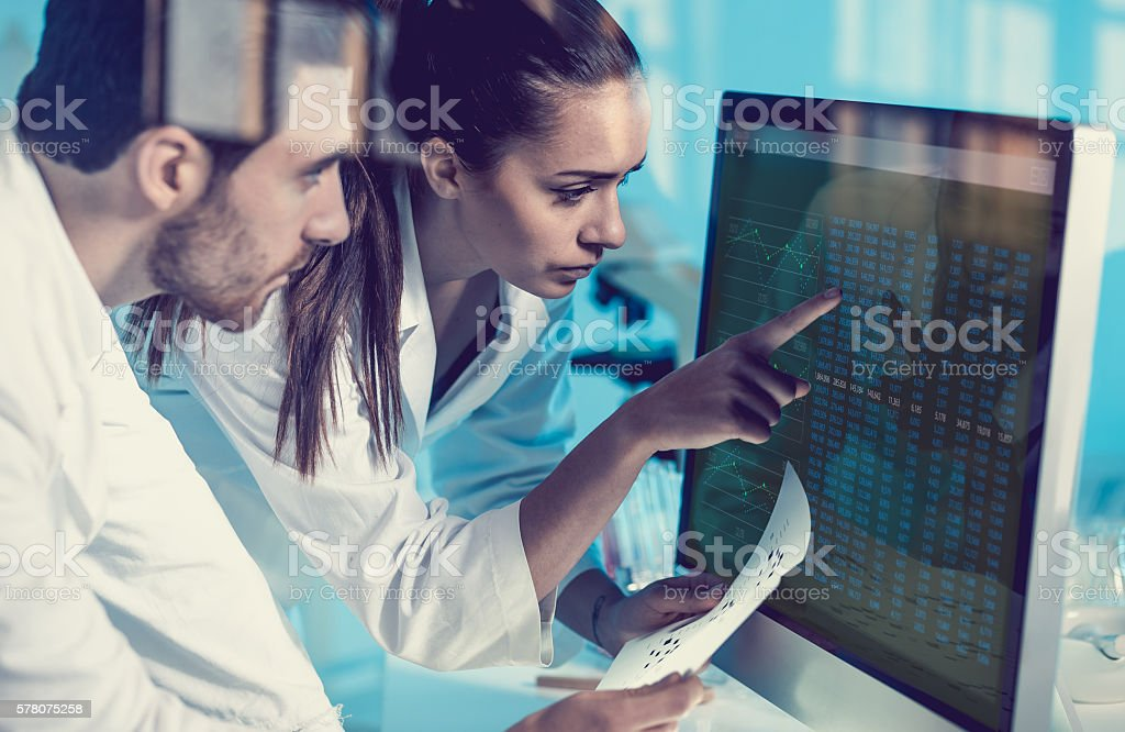 Scientist Interacting With the Computer Via Touch Screen stock photo