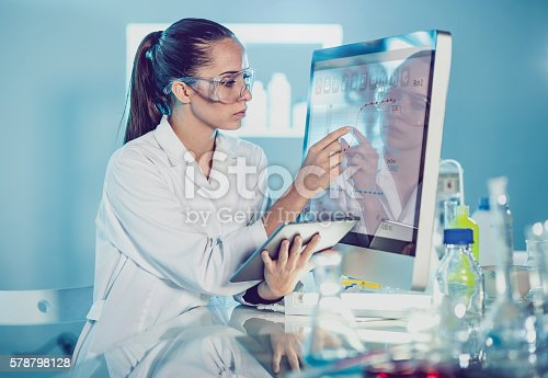istock Scientist Interacting With the Computer Via Touch Screen 578798128