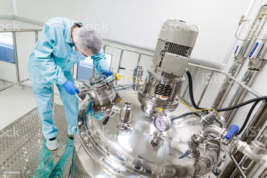 scientist is working with steel tanks royalty-free stock photo