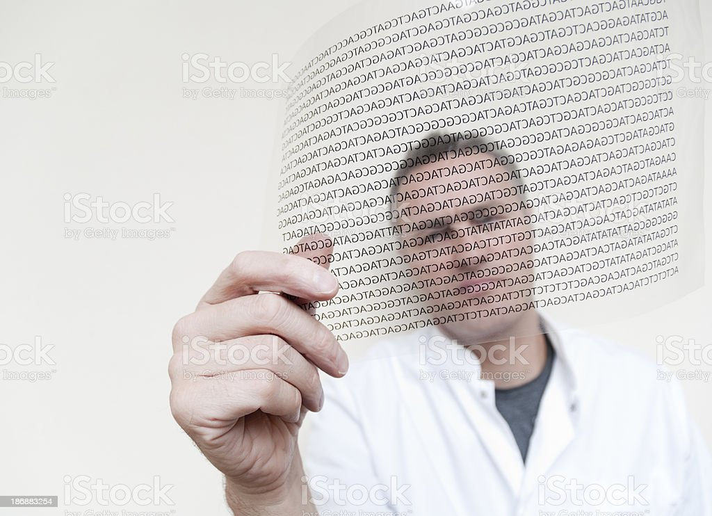 Scientist looking at DNA code royalty-free stock photo