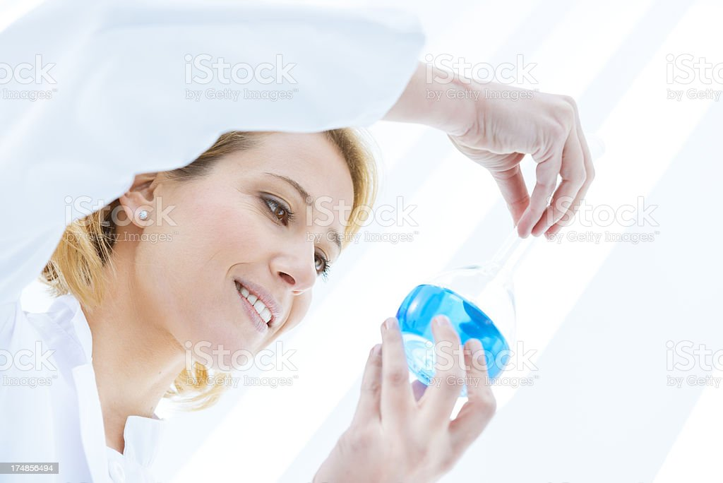 Scientist looking at flask royalty-free stock photo