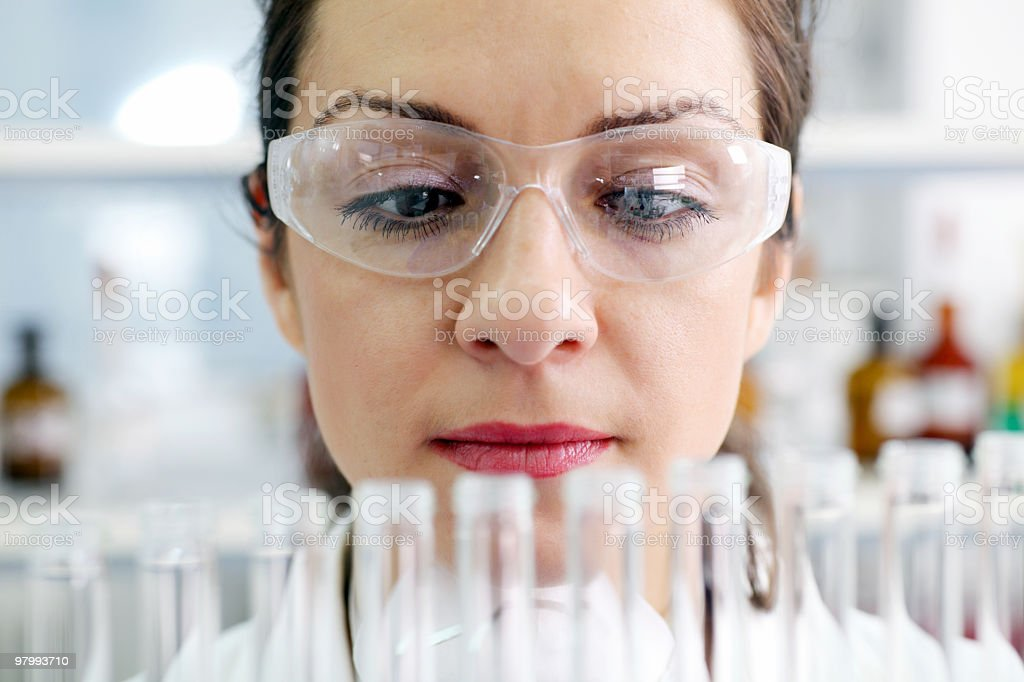 Scientist looking at laboratory flasks. royalty-free stock photo