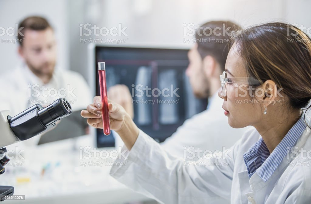 Scientist Looking at Test Tube stock photo