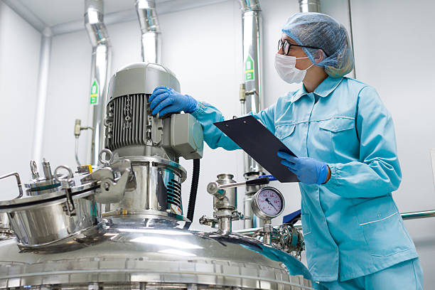 scientist monitors the readings on the equipment factory production, process, industry cleanroom stock pictures, royalty-free photos & images