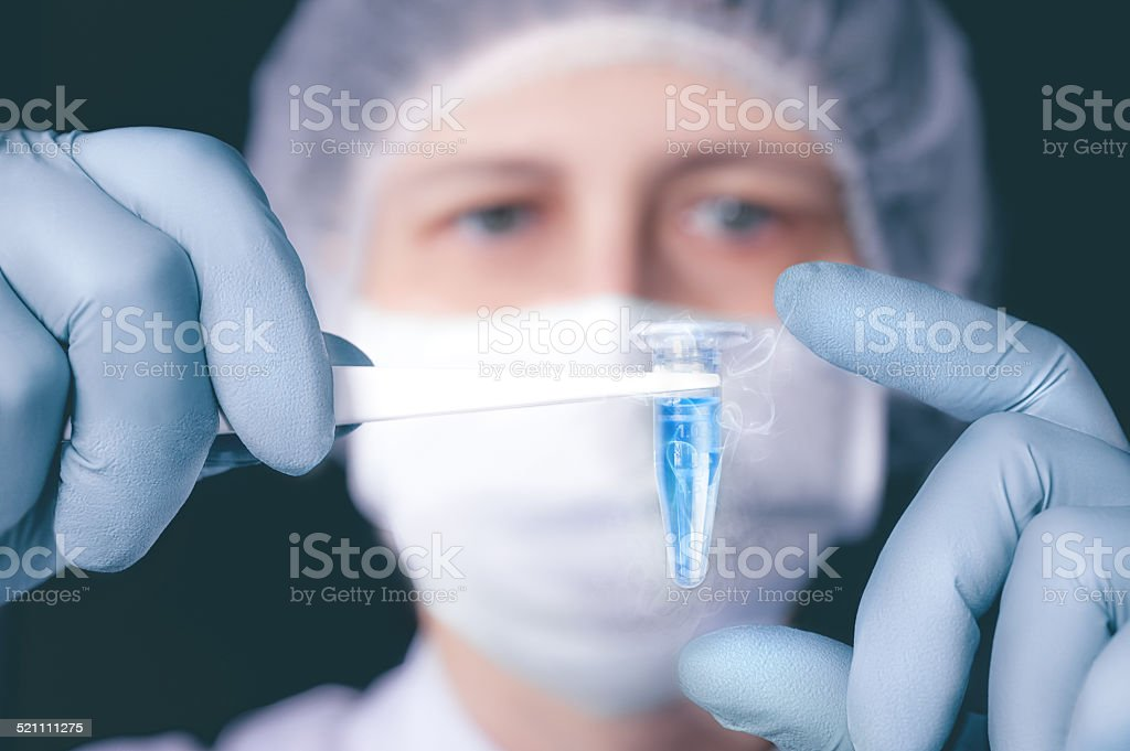 Scientist or tech holds liquid biological sample stock photo