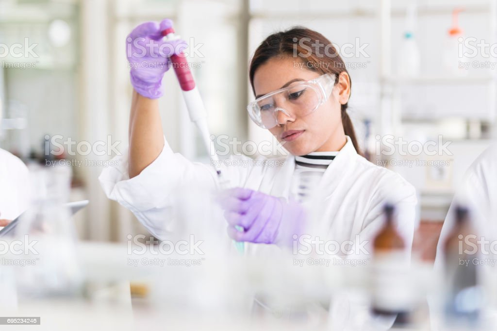Scientist pipetting stock photo