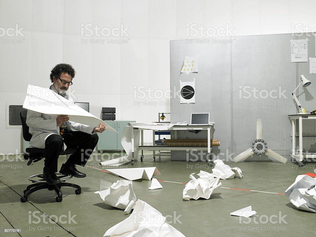 Scientist sat in chair resolving problem royalty free stockfoto