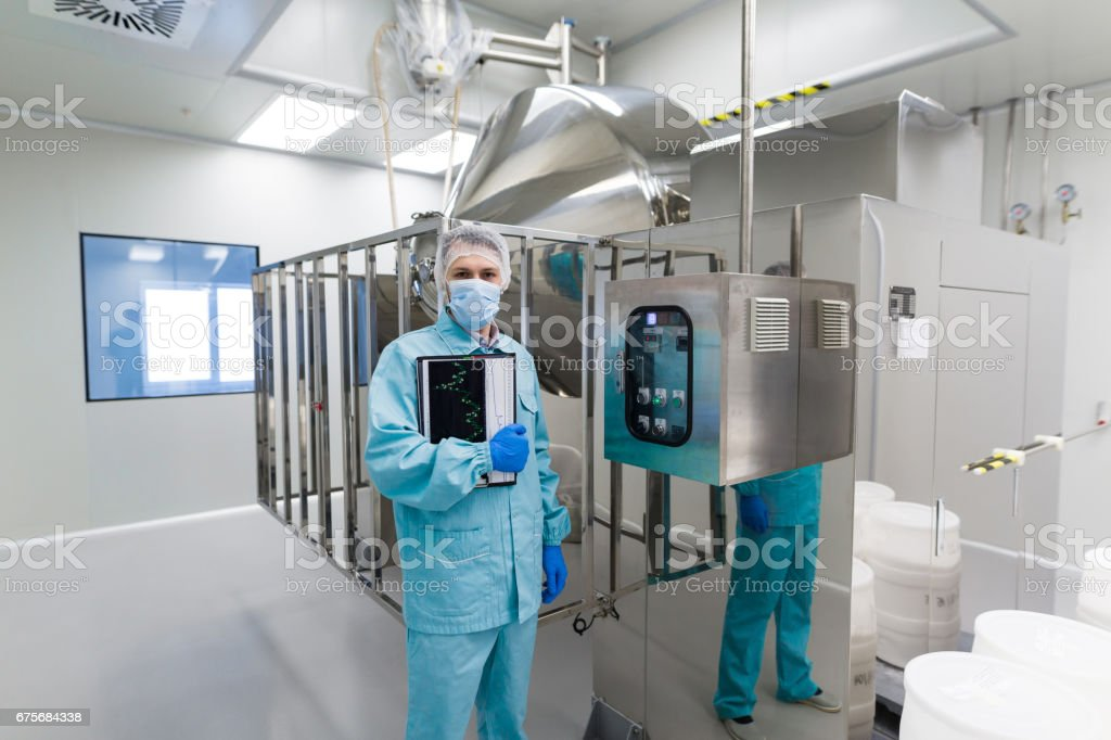 scientist stand near control panel royalty-free stock photo