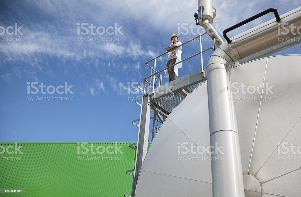 Scientist standing on walkway on tanks royalty-free stock photo