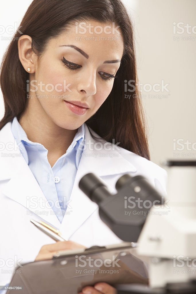 Scientist Taking Notes on Lab stock photo