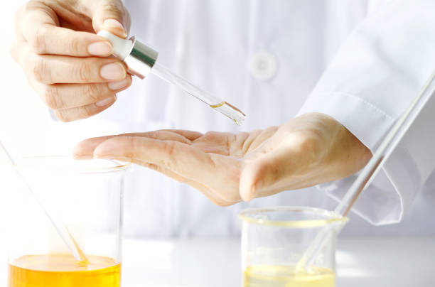 scientist testing a new organic beauty products on hand. - serum stock photos and pictures
