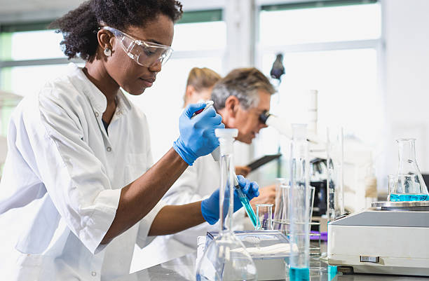 Scientist Using an Automatic Pipette stock photo