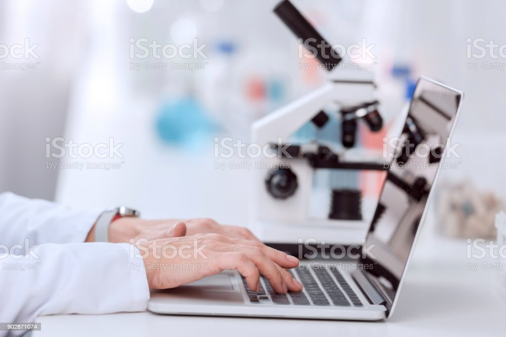 Scientist using laptop royalty-free stock photo