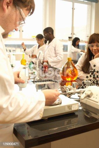 129300487 istock photo Scientist using scale in lab 129300471