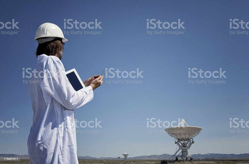 Scientist Using Smart Phone and Tablet stock photo