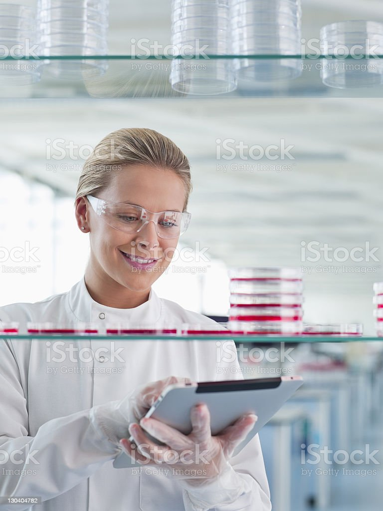 Scientist using tablet computer in lab royalty-free stock photo