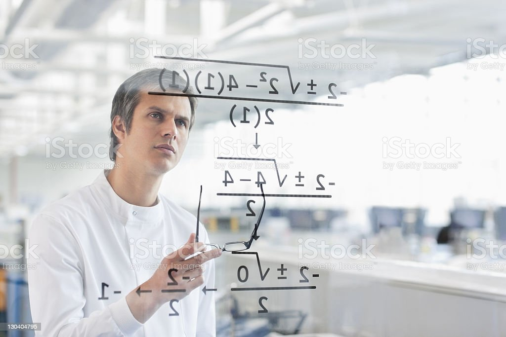 Scientist using touch screen in lab stock photo