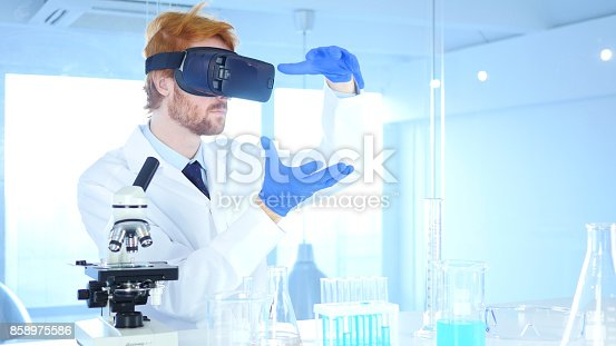 istock Scientist Using virtual reality glasses for Research and imagination in Laboratory, Vr Goggles 858975586