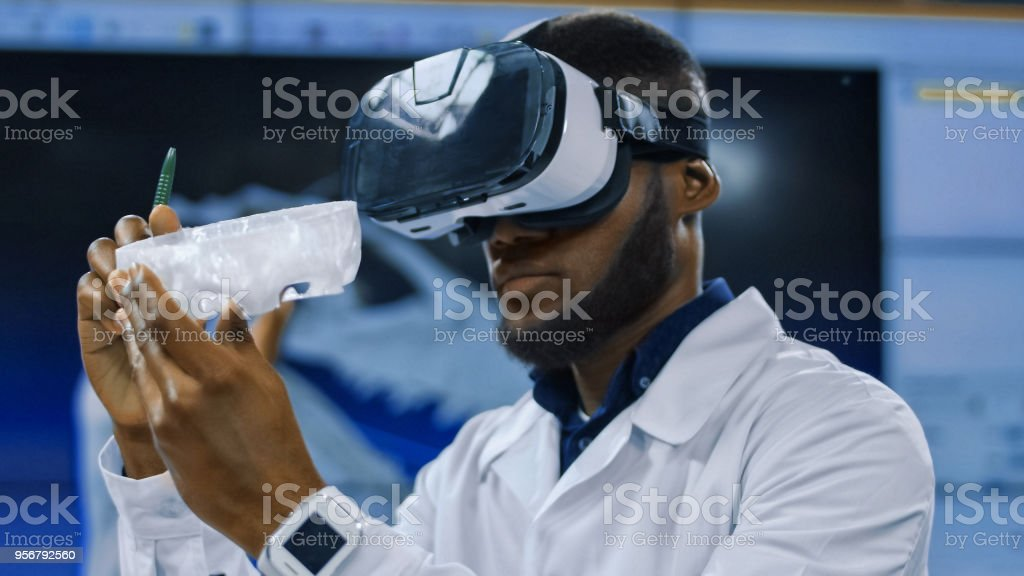 Scientist using VR glasses for exploration stock photo