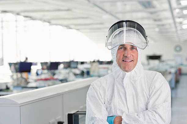 Scientist wearing protective gear in lab stock photo