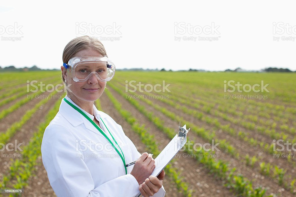 Scientist wearing protective glasses in field stock photo