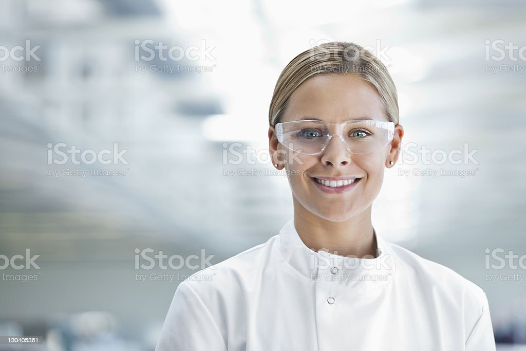 Scientist wearing protective glasses in lab stock photo